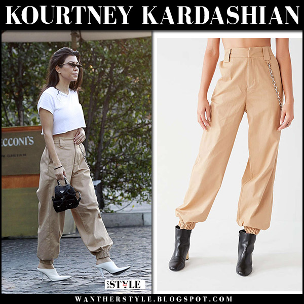 Kourtney Kardashian in white top, tan cargo pants i am gia and white mules celine street fashion november 25
