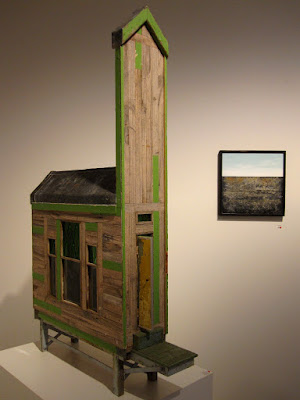 Building and wall piece on display at the Alex Asch exhibition at Beaver Galleries.