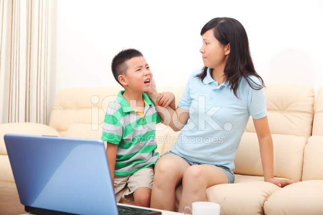 Son is fascinated by playing computer, Mom was very angry via freeimage.com