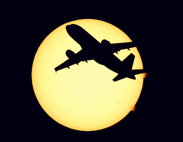 Airbus A319 Silhouette Behind Sun Scene