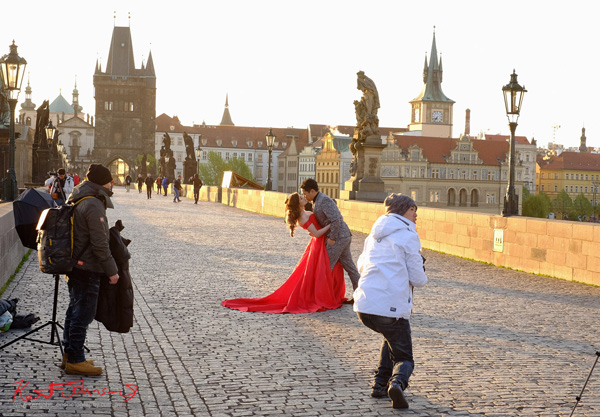 Sub zero bridal photoshoot in spring. The Charles Bridge in Spring Prague by Travel and Lifestyle Photographer Kent Johnson.