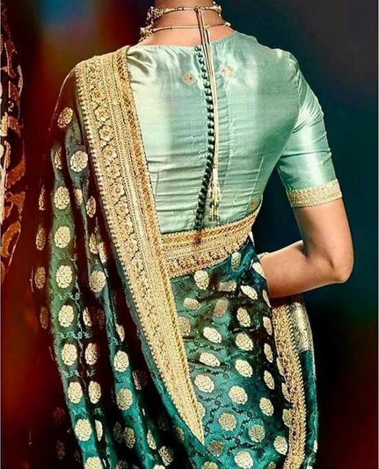 8f0ef5614db2b For a traditional silk saree look you can go for a simple blouse design  with a row of fancy buttons on the back. This type of blouse design is best  if you ...