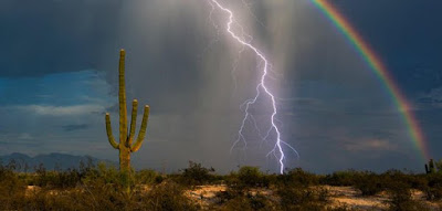 Lightning strikes as rainbow forms in the Arizona desert
