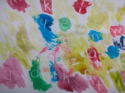 finished secret message painting showing the lowercase alphabet