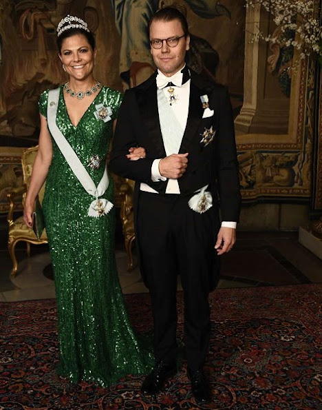 Crown Princess Victoria wore Green gown and Anya Hindmarch Gold Metallic Clutch Princess Sofia wore red gown and  silver diamond Metallic Clutch, diamond tiara.