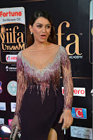Hansika Motwani in Glittering Deep Neck Transparent Leg Split Purple Gown at IIFA Utsavam Awards 21.JPG