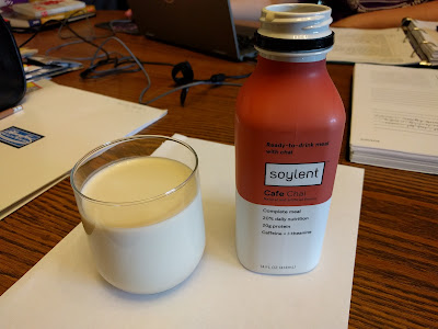 Soylent Cafe Chai, in a bottle and a clear glass