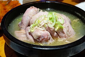 Small Whole Chicken in a Bowl of Broth