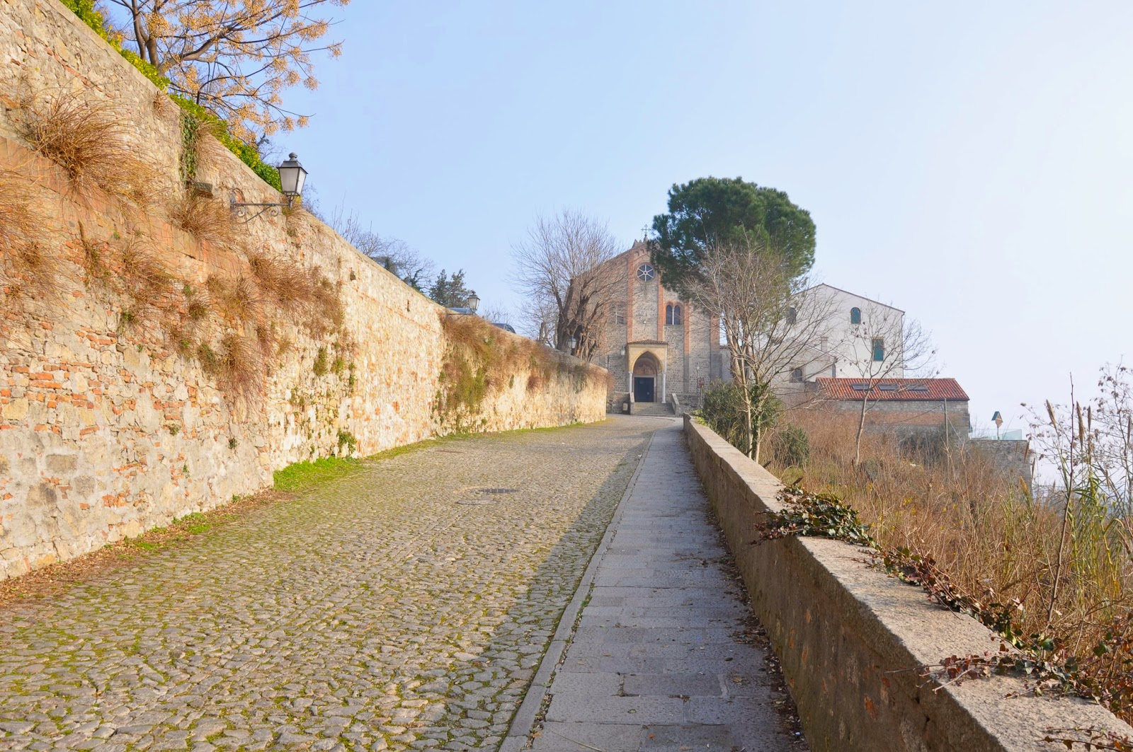 steep cobbled road old church Monselice Italy