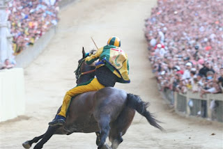 Packed crowds line the narrow circuit for the Palio di Siena