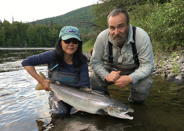Hyun with a handsome September buck salmon and great guide, Daryl, from Middle Camp. Grand Cascapedia, Quebec