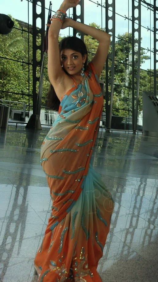 Actress Kajal agarwal hot orange saree images