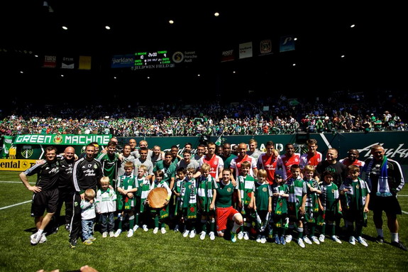 Portland Timbers and The Green Machine pose for a photo after the match