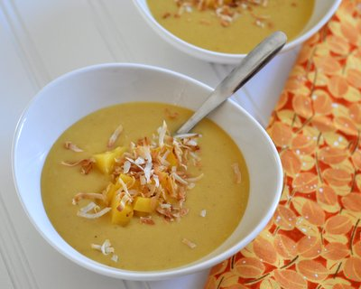 Butternut Squash Soup with Mango & Toasted Coconut, another easy vegan summer salad ♥ AVeggieVenture.com, a smooth almost custard-like soup, served chilled on warm days or warm on chilly days. Beautiful Color. Great for Meal Prep.