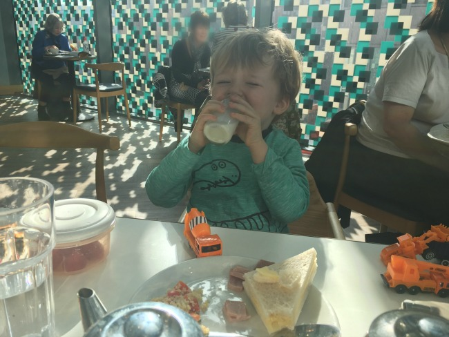 Bloggers-Lunch-at-Benugo-John-Lewis-Cardiff-toddler-drinking-from-milk-bottle