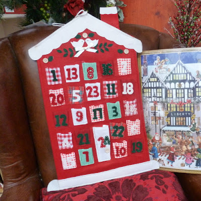 Red and white advent calendar with dove design