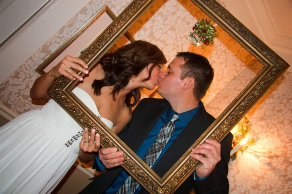 More kisses under the mistletoe with a bridesmaid and her date