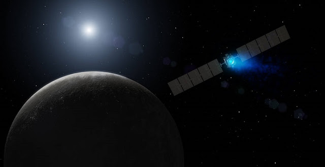 This artist's concept shows NASA's Dawn spacecraft arriving at the dwarf planet Ceres, the most massive body in the asteroid belt. Image credit: NASA/JPL-Caltech