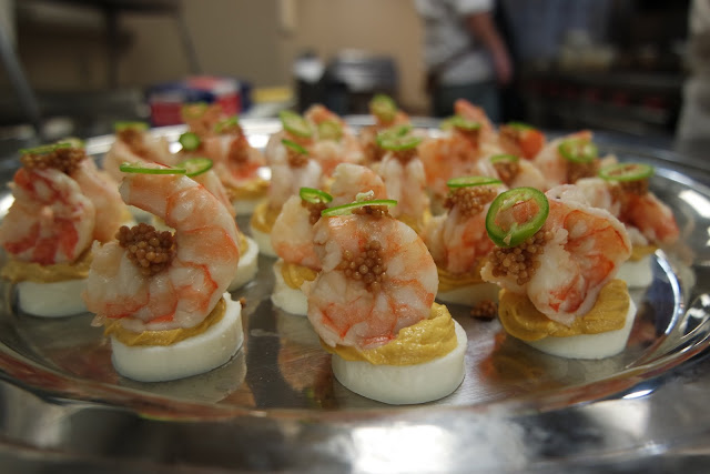 Jay D's Molasses Mustard Deviled Egg topped with Pickled Shrimp, Pickled Mustard Seeds and Serrano