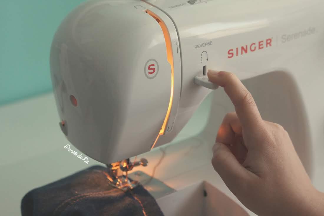Máquina de coser, partes y funciones principales - Palanca de retroceso