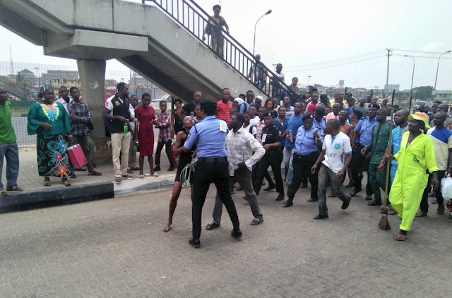 Lady Arrested As Buhari Visits Lagos For Trying To Use A Bridge Shut Down