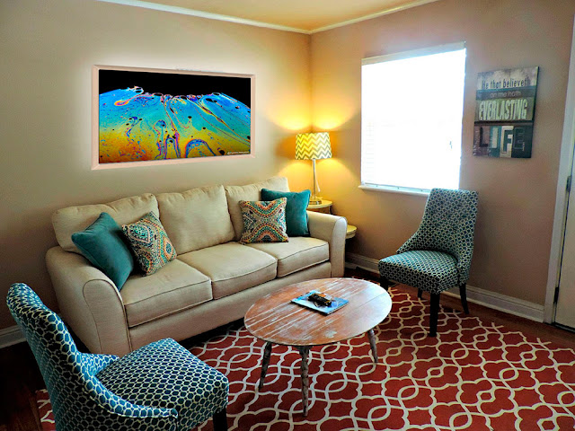 Living room displaying the wall decor of fine art photograph