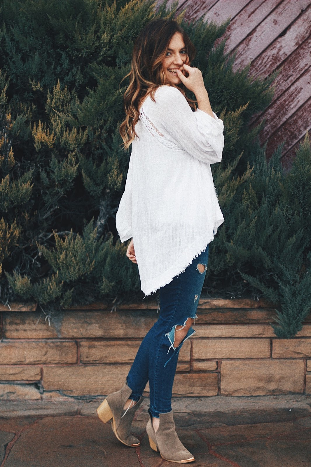 free people casual peasant blouse ripped jeans outfit