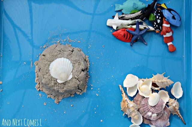 Ocean themed invitation to play using sand foam sensory dough