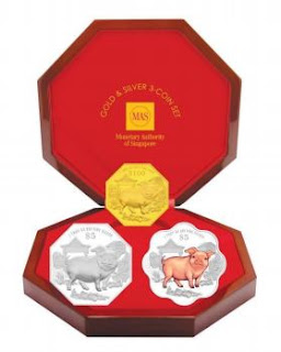 Source: MAS. A gold and silver set of coins.