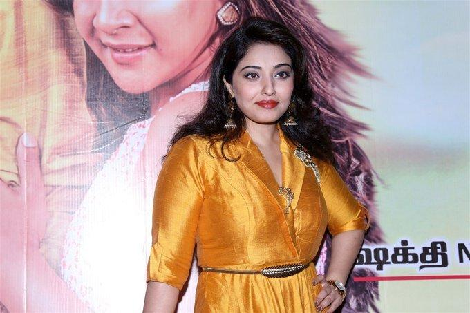 Model Mumtaj In Yellow Dress At Audio Release Function