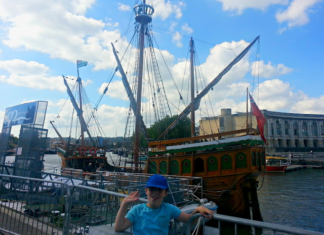 Boy standing in front of The Matthew on Bristol Harbourside
