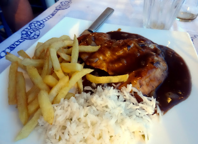 Grilled Chicken in Sauce at the Fish Market - Old Port in Skiathos Island, Greece
