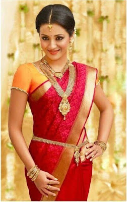 A very comfortable and dashing South Indian wedding saree.
