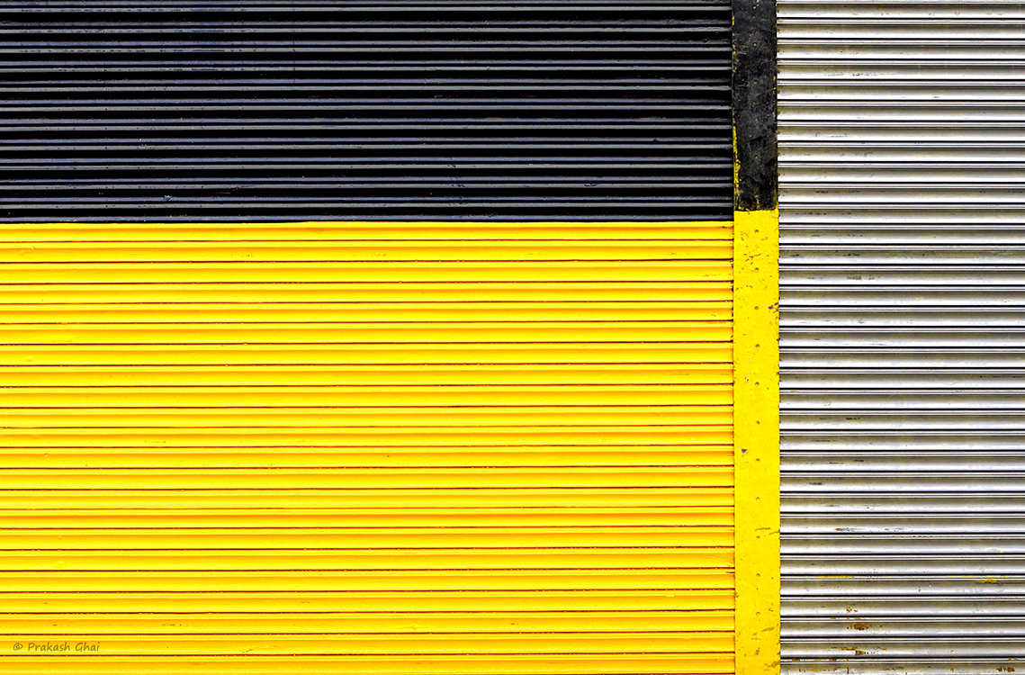 A minimalist photo of A colorful metal shutter with lines
