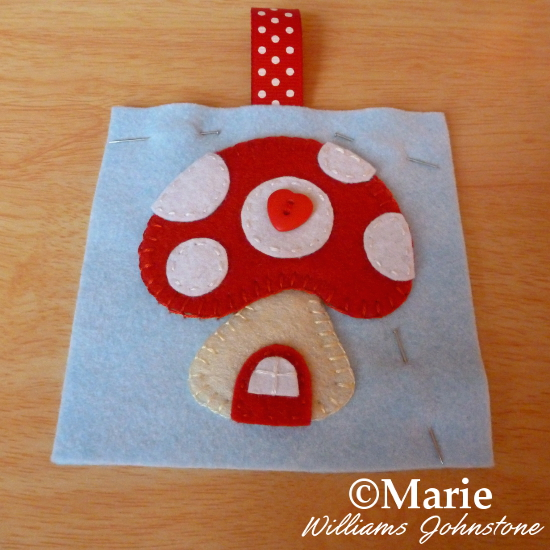 Pinning front and back of wool blend felt pincushion pieces