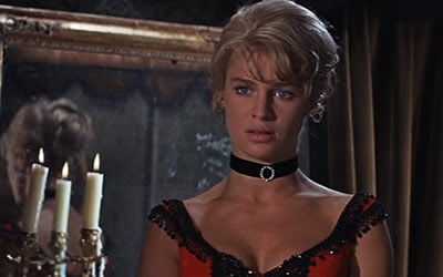 Julie Christie as Lara, ravishing in a red dress, adorning a necklace, Dr. Zhivago (1965), Directed by David Lean