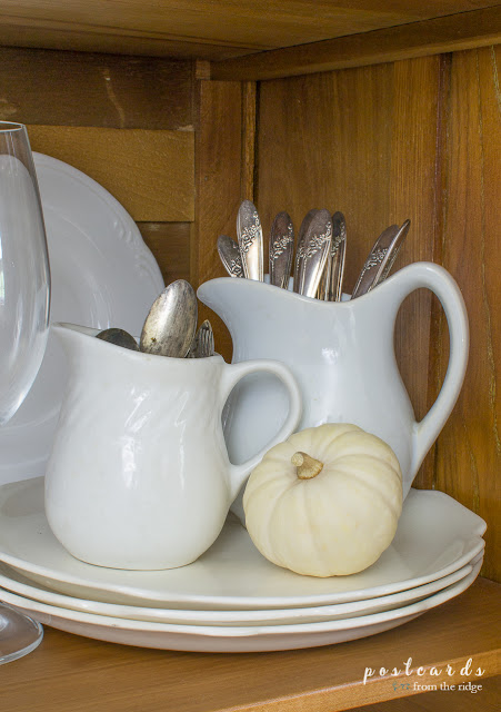 old silverware in little white ironstone creamers