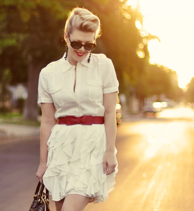 twisted hair, white dress, red lips