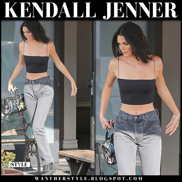 Kendall Jenner in black crop top, grey yeezy jeans and black hiking boots alyx model style july 18