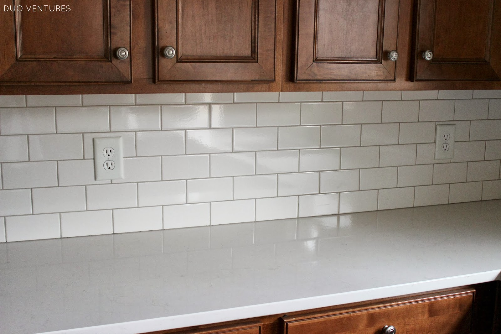 Gray Ceramic Tile Backsplash Duo Ventures Kitchen Update Grouting And Caulking Subway