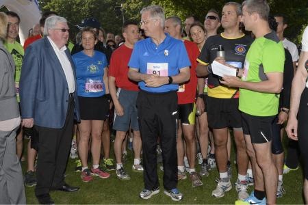 King Philippe and Queen Mathilde attend the 35th edition of Brussels' 20 km running race