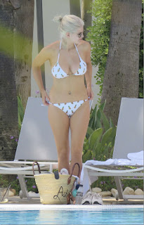 Ashley James - Bikini around the pool in Marbella