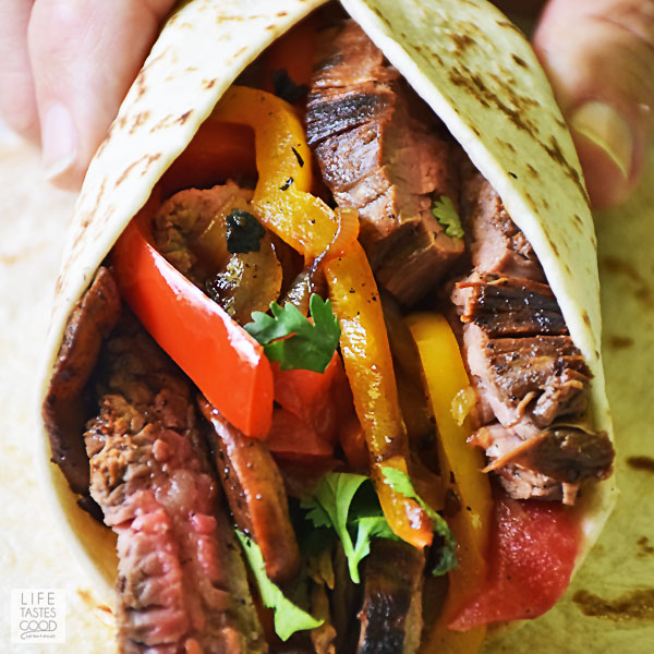 Flank Steak Fajitas Recipe close up picture of fajita filling wrapped in warm tortilla