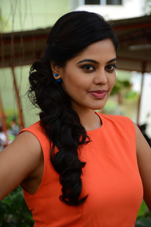 Actress Bindu Madhavi Hot Face Closeup In Orange Dress