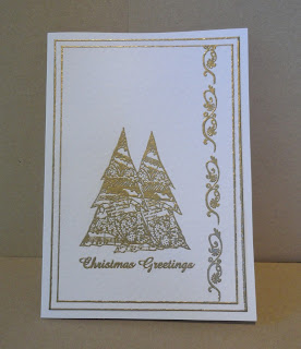 "White and gold Christmas card with two trees and ""Christmas Greetings"" sentiment"