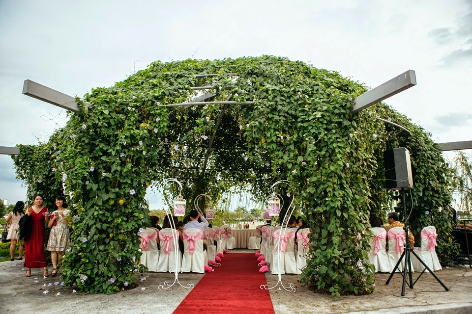 big arch made of real leaves flowers