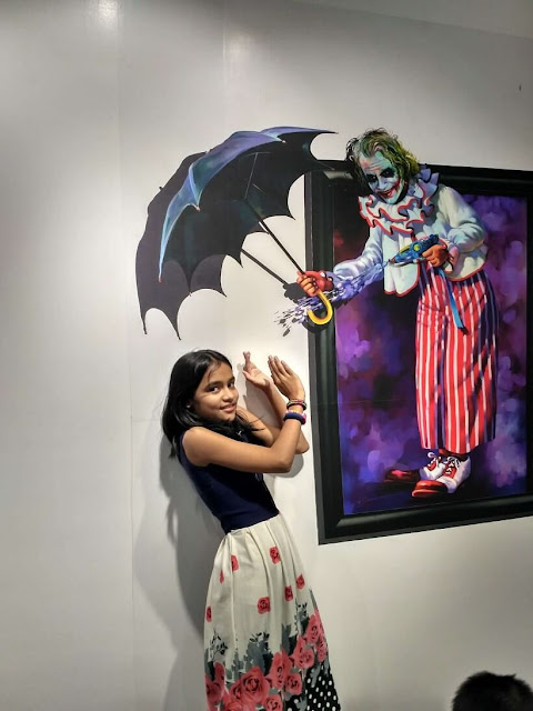 3 Dimensional painting on wall of joker shooting