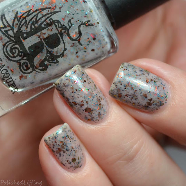 off white crelly nail polish with ucc flakies