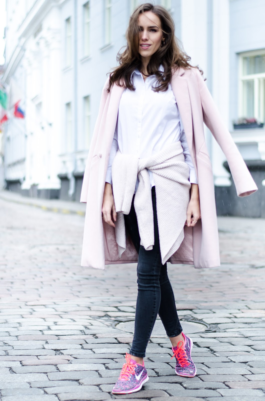 layered winter outfit sweatshirt around waist