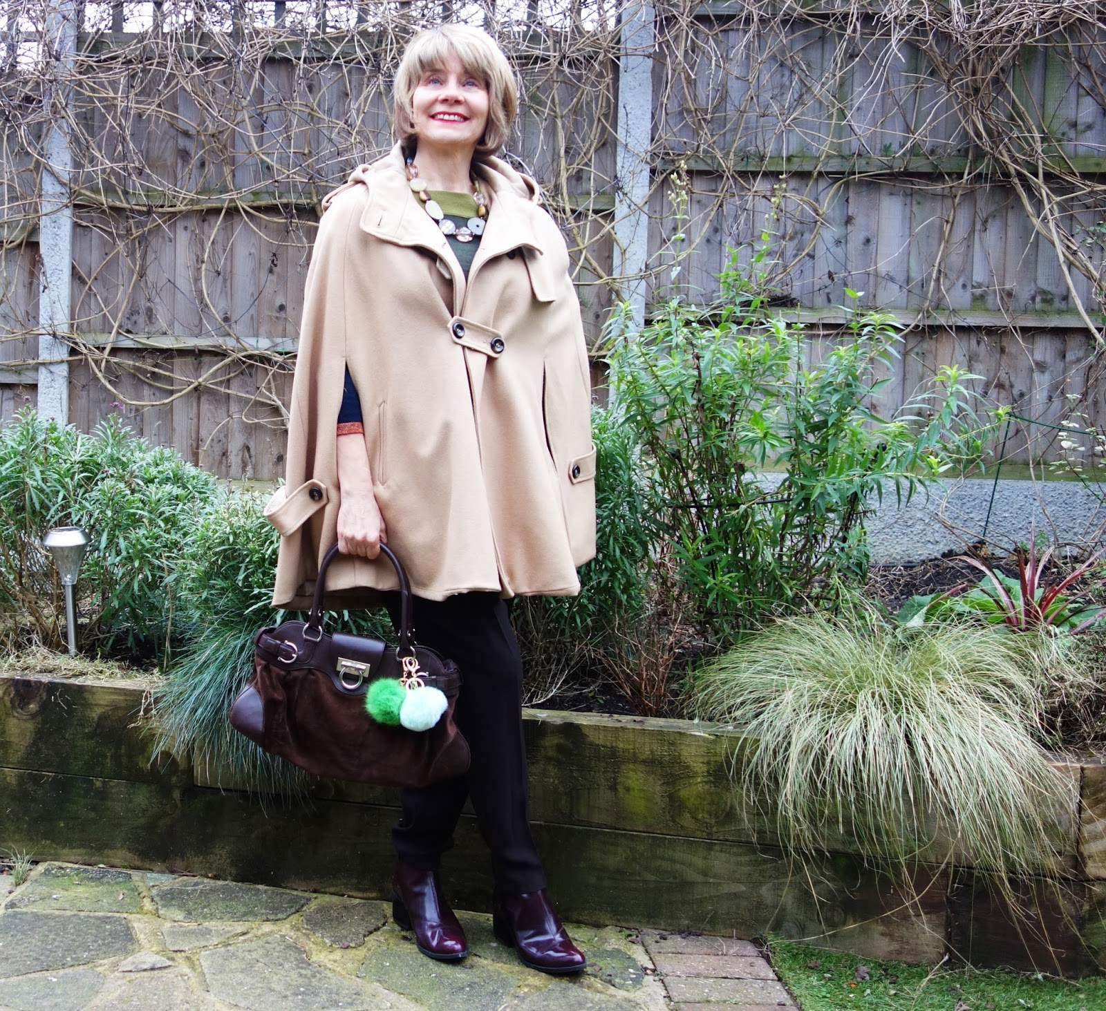 Gail Hanlon blogger wearing brown and green shades